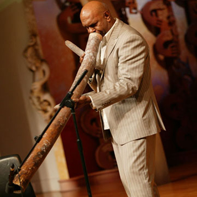 Aboriginal performer and Aboriginal artist Walangari Karntawarra plays the didgeridoo at his exhibition at Te Papa in New Zealand
